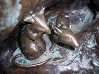 mice on peter pan statue